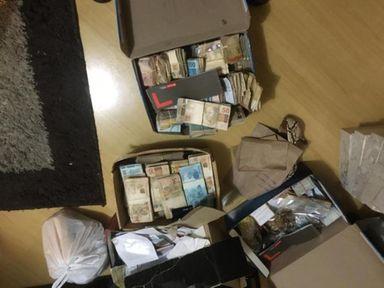 Dinheiro encontrado na casa de um dos sócios da empresa. (Foto: PF)